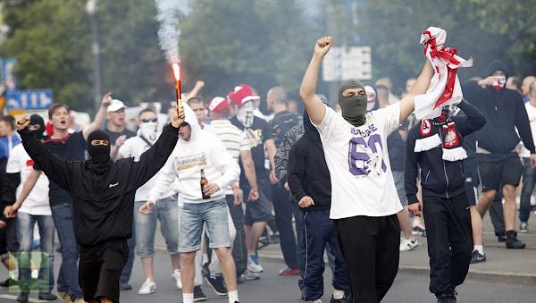 Polish soccer fans shout as Russian fans march to the National Stadium in Warsaw